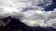 Massive clouds over mountain range: timelapse video