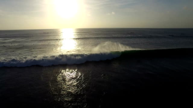 A massive wave breaking in the sunset (Bali, Indonesia) video