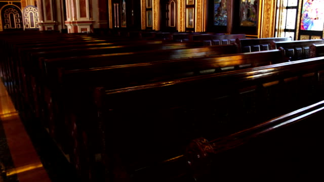 massive wooden benches in church video