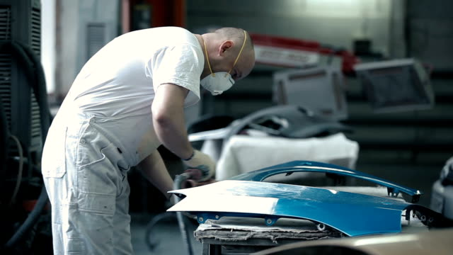 Master polishes the details of the car bumper. video