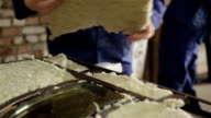 Master puts the insulation inside the doors. video