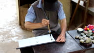 Master writes ancient Chinese calligraphy on rice paper. video