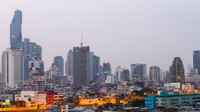Matching Day & Night:4K TIME LAPSE Night TO Day (4096x2160) : The building office and cityscape at Bangkok, Thailand (Apple ProRes. 422(HQ)) video