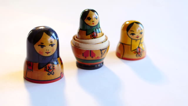 Matryoshka Doll rotates on a white background in FullHD video