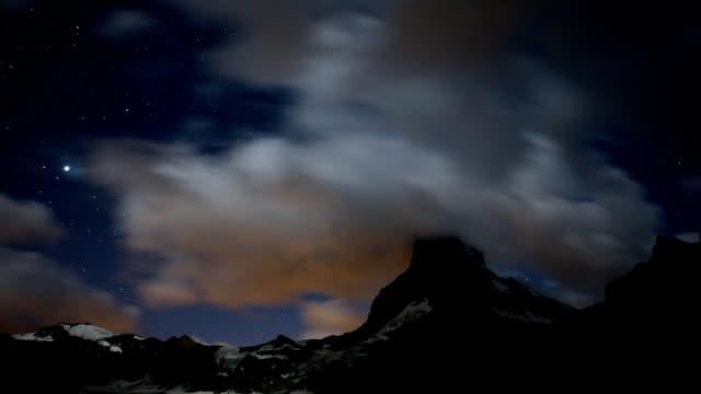 Matterhorn Night Timelapse - stars, clouds and a mountain video