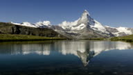 Matterhorn reflected in an alpine lake. (Time-lapse) video