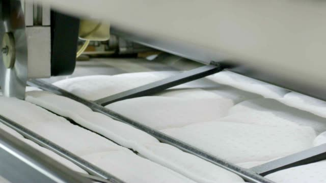 Mattresses manufacturing , mattresses Plant, Sewing of mattresses on the sewing machine video