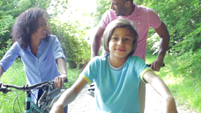 Mature African American Couple Running Along Country Path African American Family On Cycle Ride In Countryside video