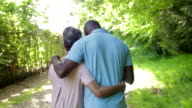 Mature African American Couple Walking In Countryside video