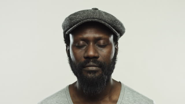 Mature african man with flat cap in studio video