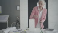 4K: Mature Architect working in her office. video