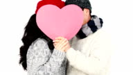 Mature Asian couple covering their face wit a pillow heart video