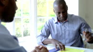 Mature Black Male Meeting With Financial Advisor At Home video