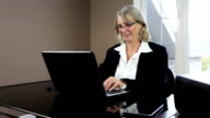 Mature business woman in office video