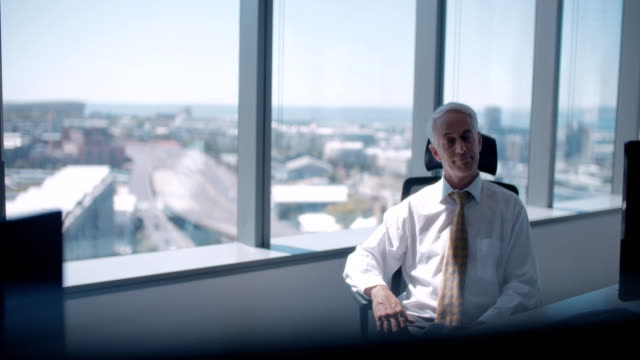 Mature businessman taking a break from work video
