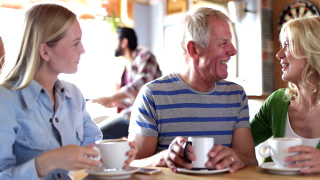 Mature Couple and their Daughter Sitting in Cafe video