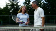 Mature couple at tennis court video