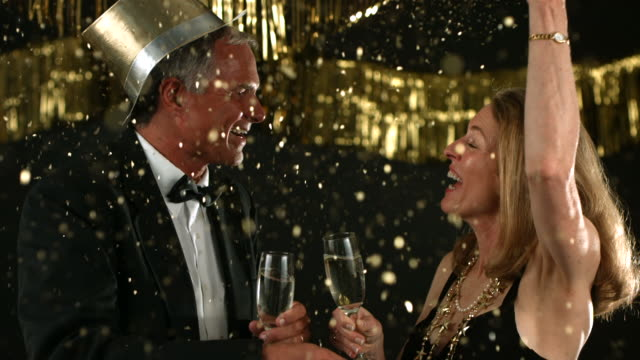 Mature couple celebrate New Year's Eve video
