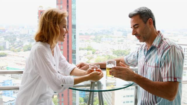 Mature Couple Celebration Vacation Drinks video