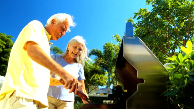 Mature Couple Cooking Healthy Food Outdoors video