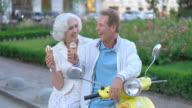 Mature couple eating ice cream. video