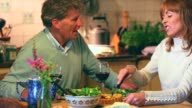 Mature couple having dinner together talking video