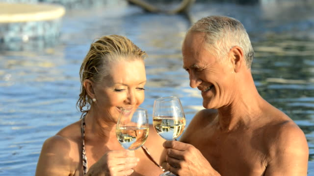 Mature couple in a swimming pool video