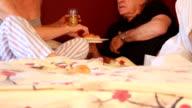 Mature couple in bed having breakfast video