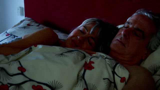 Mature couple in bed sleeping video