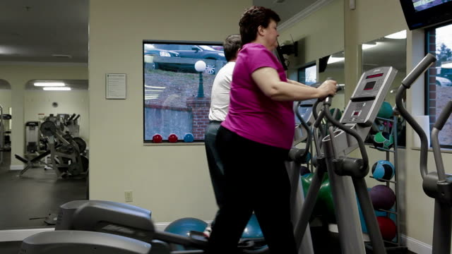 Mature Couple In Fitness Center video