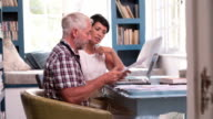 Mature Couple In Home Office Looking At Paperwork video