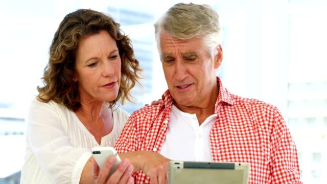 Mature couple is looking some electronic devices video