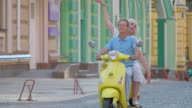 Mature couple is riding scooter. video