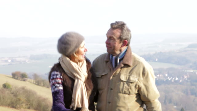 Mature couple on country walk in winter video