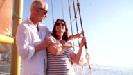 Mature couple on their sailing yacht with blue sky video