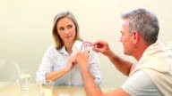 Mature couple playing cards together at the table video