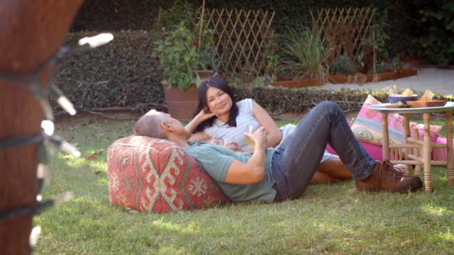 Mature Couple Relax In Garden Together Shot In Slow Motion video