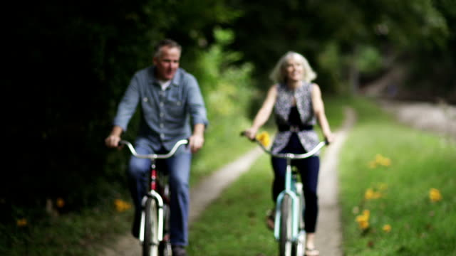 Mature Couple Riding Bicycles At Park. video