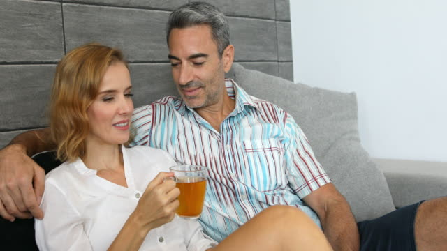 Mature Couple Sitting at Home Together Watching TV video