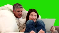 Mature couple using a laptop on their sofa video