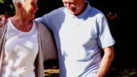Mature couple walking in a park video