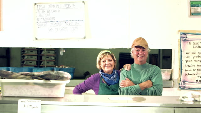 Mature couple working fish market video