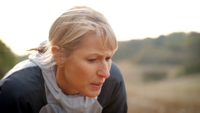 Mature Female Runner Resting During Exercise In Slow Motion video