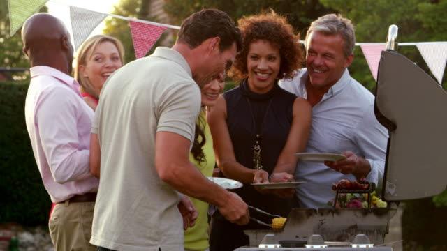Mature Friends Enjoying Outdoor Barbeque Shot On R3D video