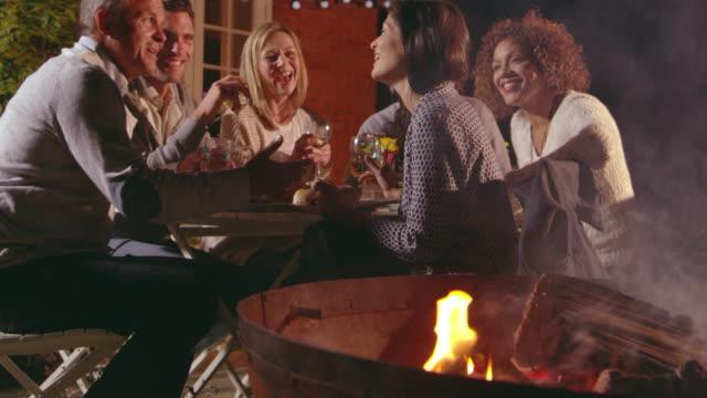 Mature Friends Enjoying Outdoor Evening Meal Shot On R3D video