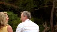 Mature happy couple sitting talking video
