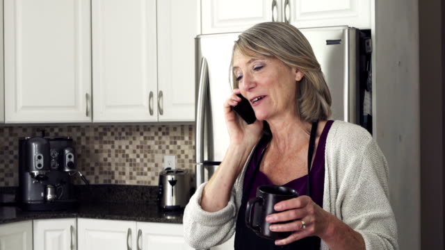 Mature lady in the kitchen video