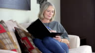 Mature lady writing a letter video