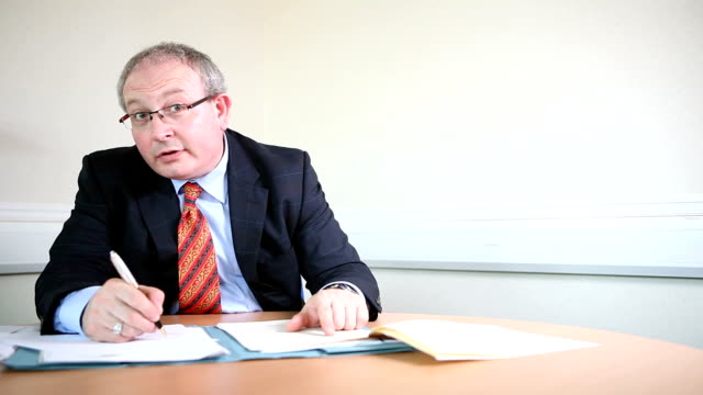 Mature lawyer in discussion with client video