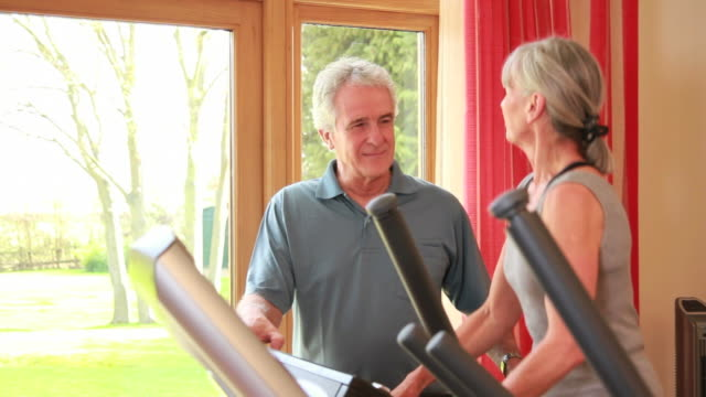Mature male and female exercising video